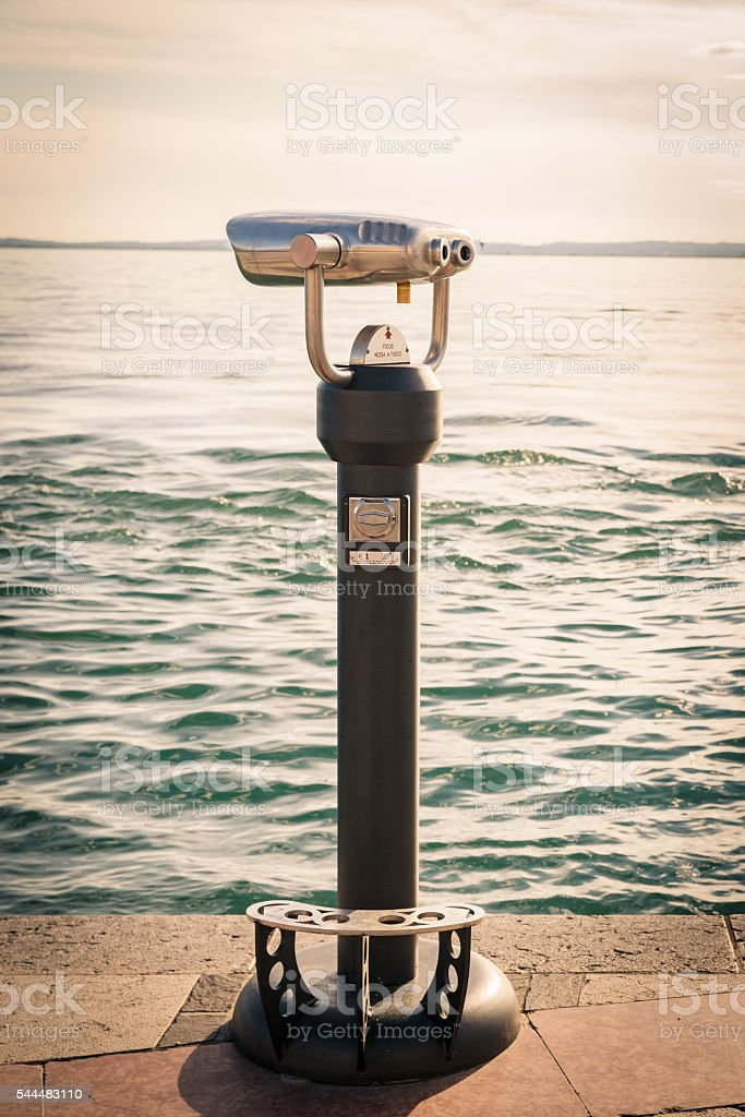 Coin Operated Binocular viewer next to the waterside. stock photo