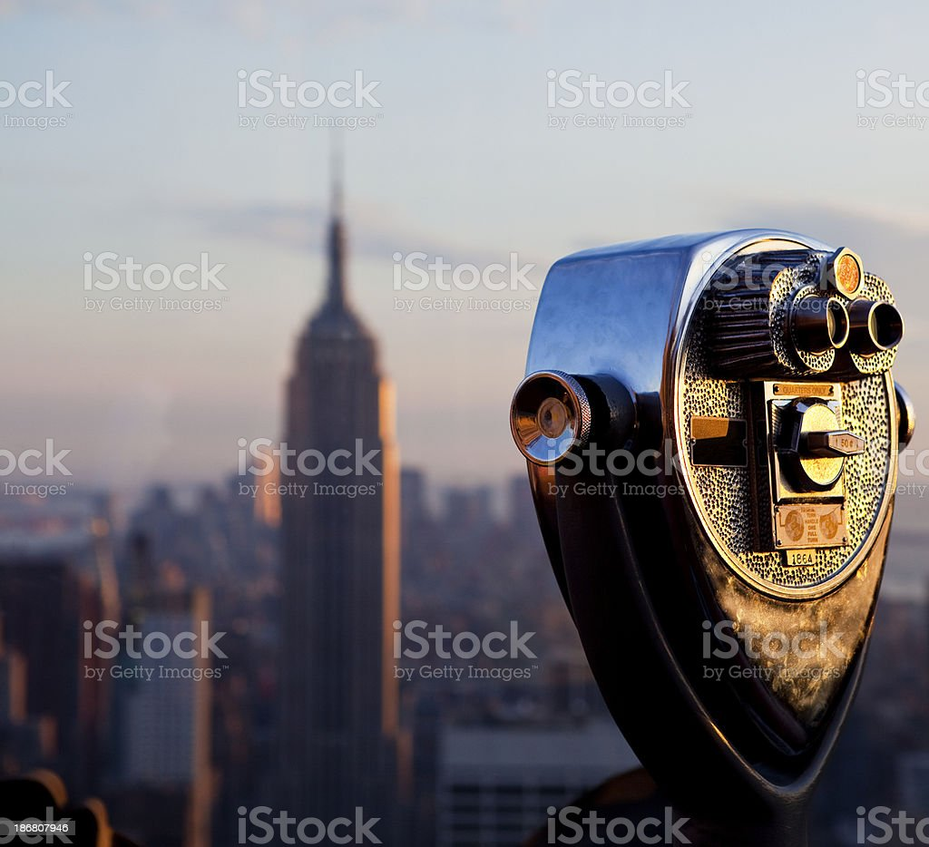 Coin operated binoculars and Empire State Building stock photo