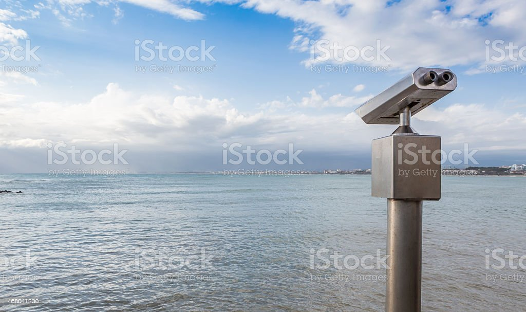 Coin operated binoculars for beach observation stock photo