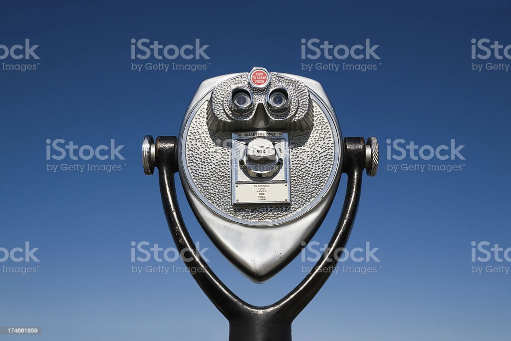 Coin Operated Binoculars set against blue sky background stock photo