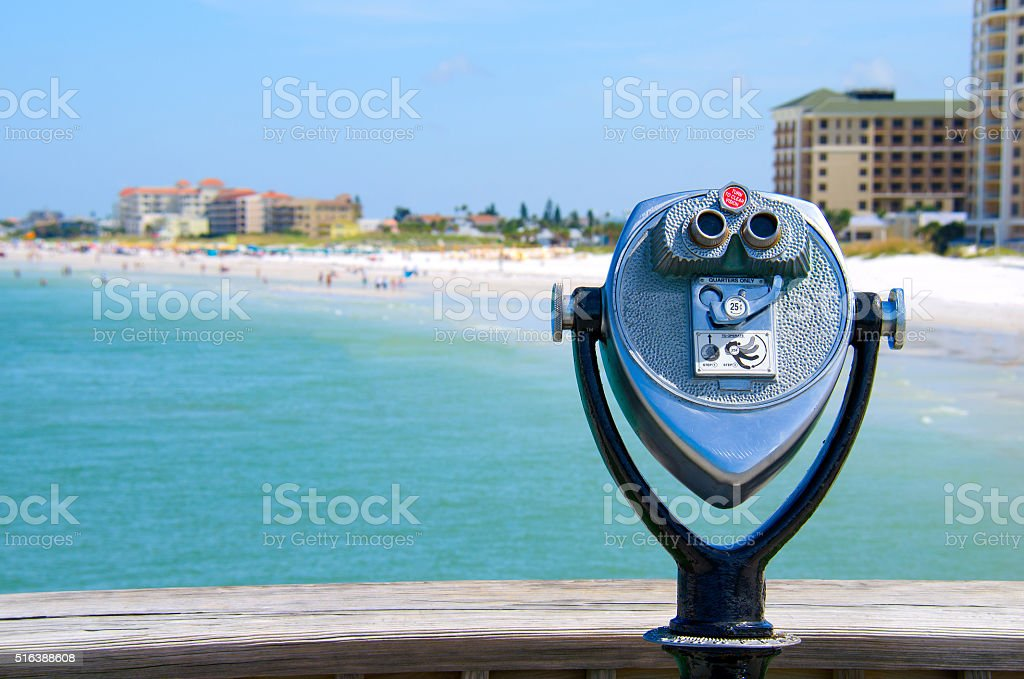 Coin operated high power binoculars at the beach stock photo