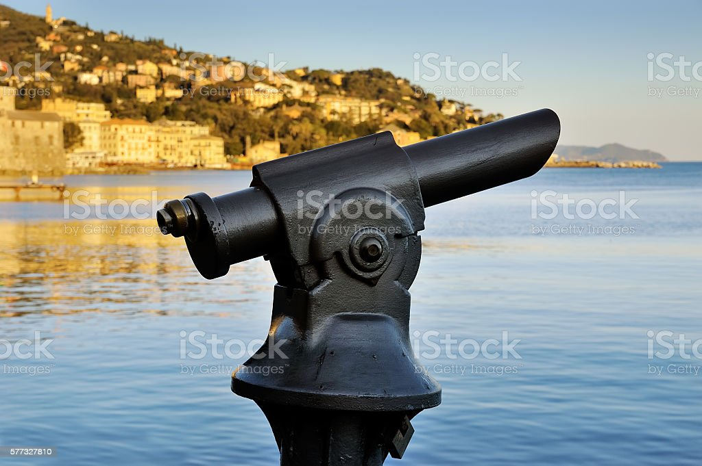 Coin operated monocular telescope at Italy stock photo
