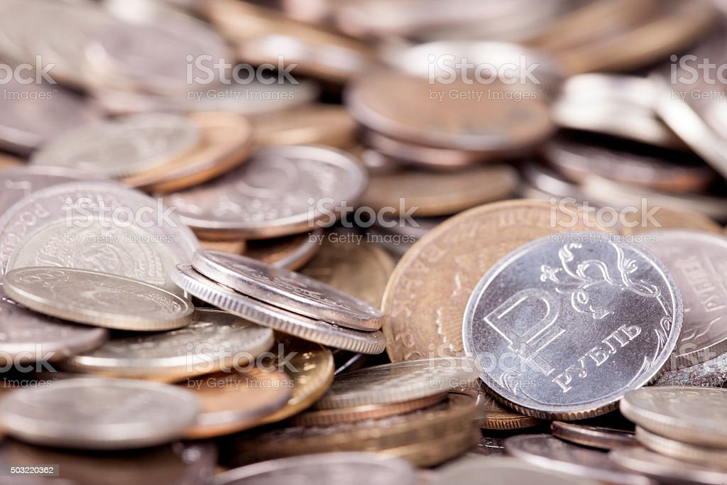 coin ruble among many other coins stock photo