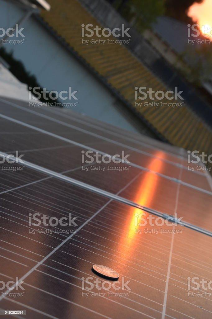 Coin, solar panel stock photo