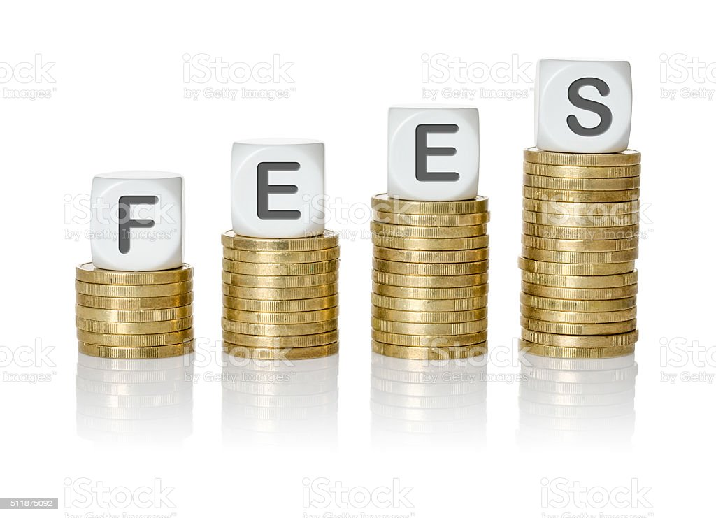Coin stacks with letter dice - Fees stock photo