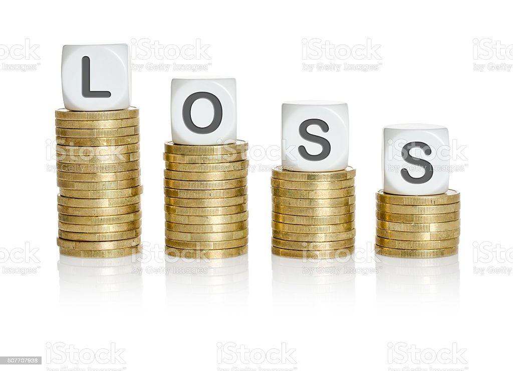 Coin stacks with letter dice - Loss stock photo