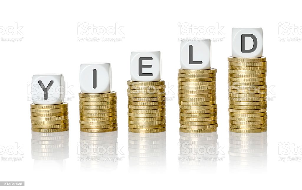 Coin stacks with letter dice - Yield stock photo