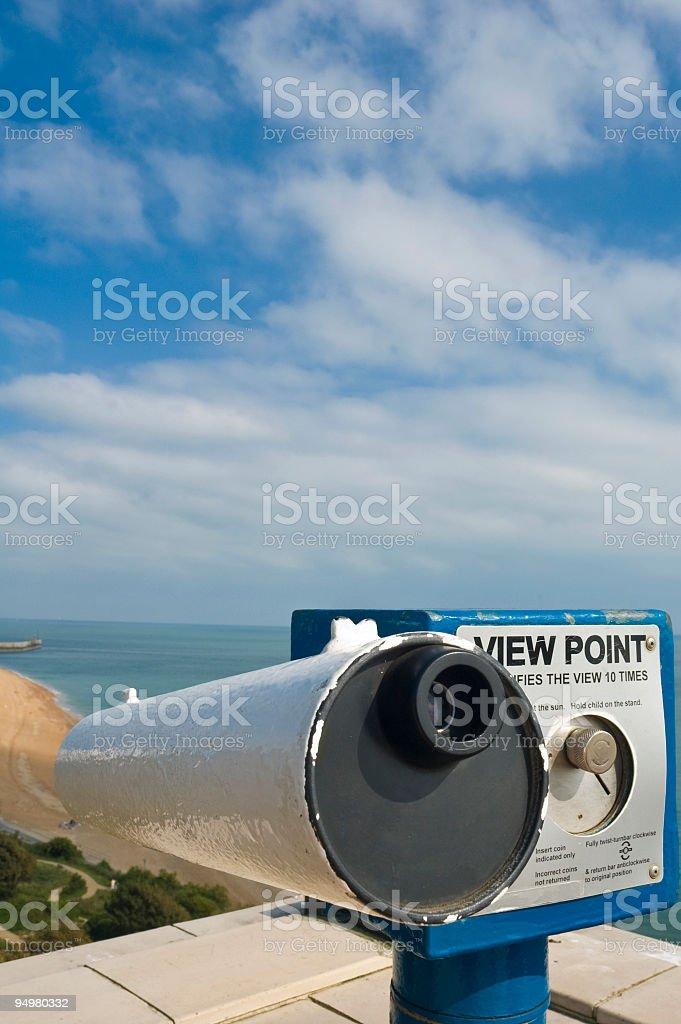 Coin telescope overlooking beach stock photo