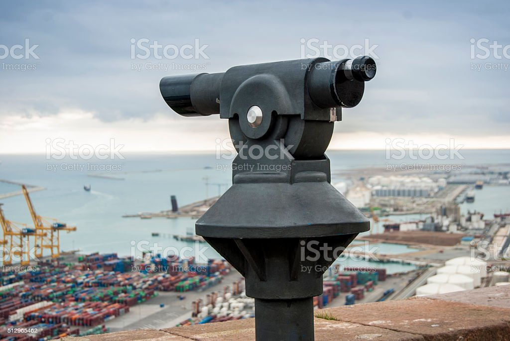 Coin viewer looking out at the Barcelona harbour. stock photo