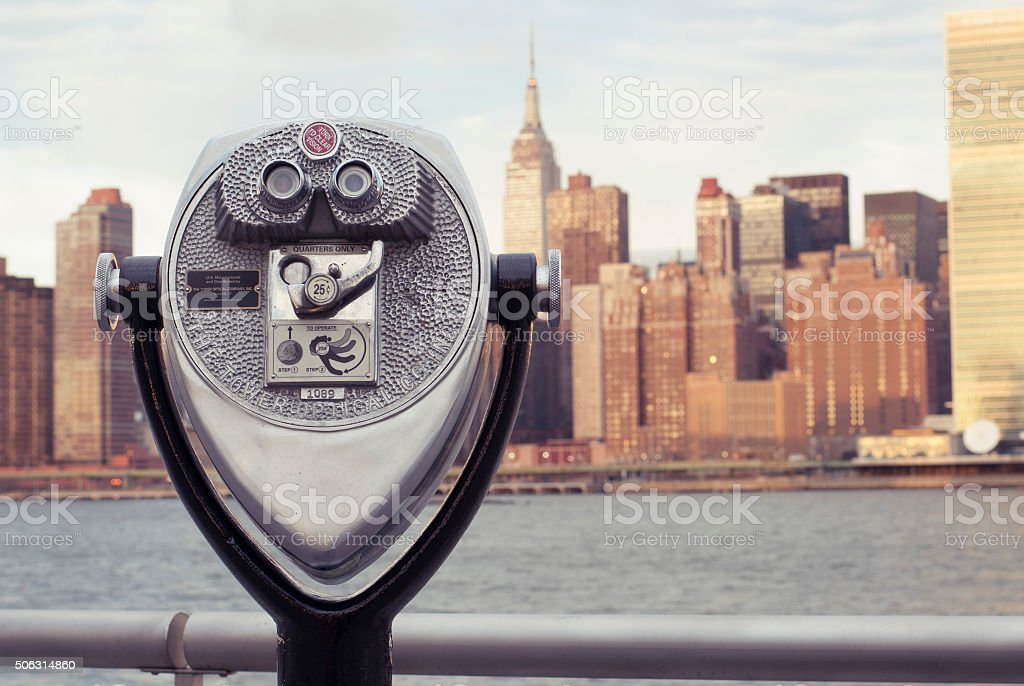 Coin-operated Binocular looking at Manhattan Island from Long Island City stock photo