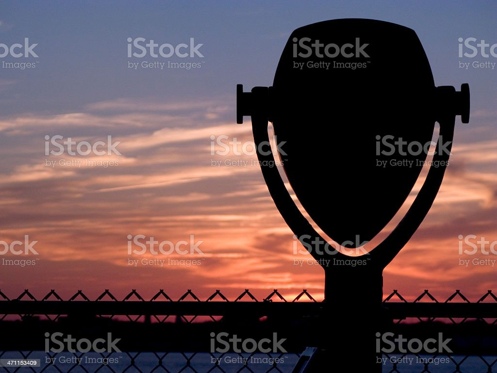 Coin-Operated Binoculars With Brilliant Sunset & Cloudscape, Silhouette stock photo