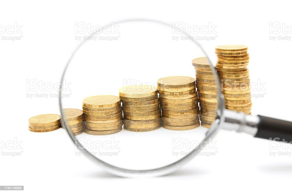 Coins and a magnifier. stock photo