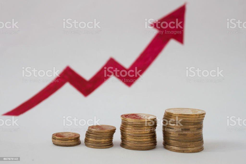 coins and arrow stock photo
