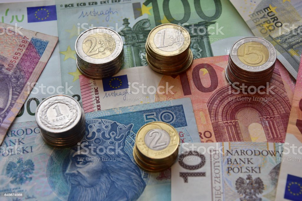 coins and banknotes EUR and PLN stock photo