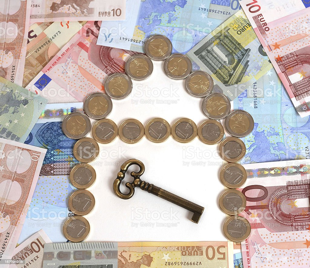 Coins and Banknotes Real State with Key royalty-free stock photo