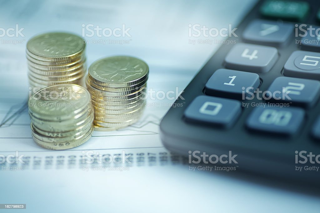 coins and caculator stock photo