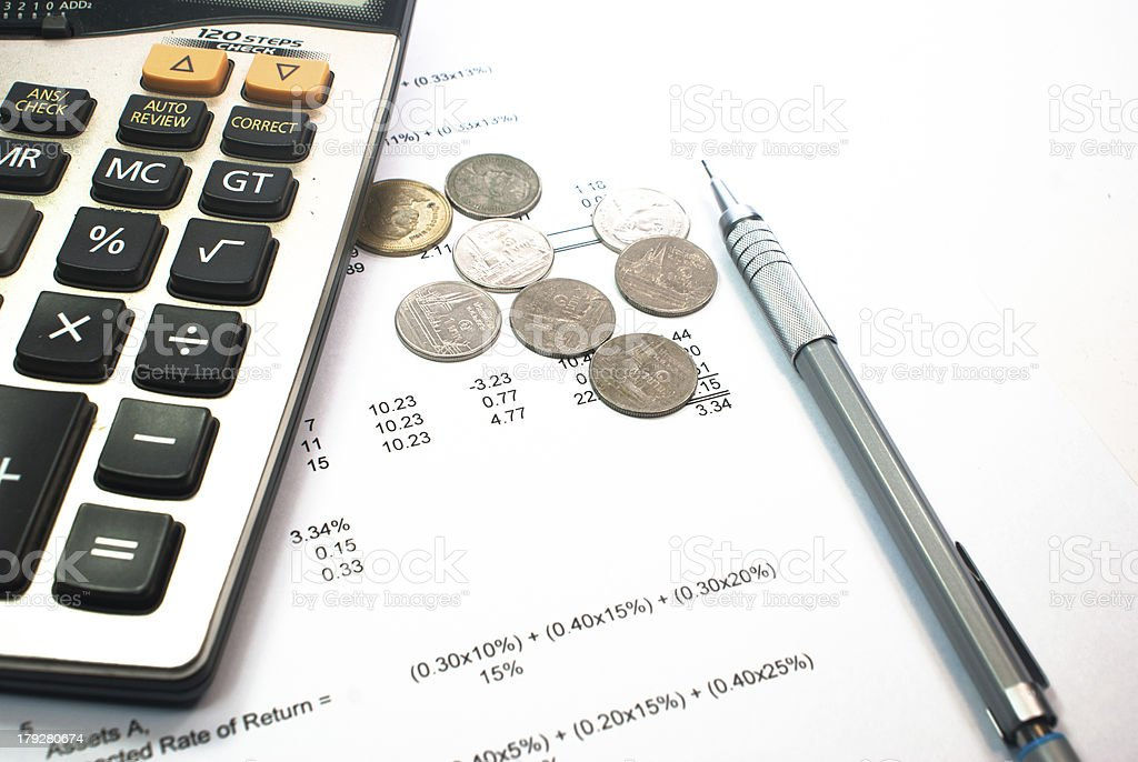US coins and calculator pen on financial figure royalty-free stock photo