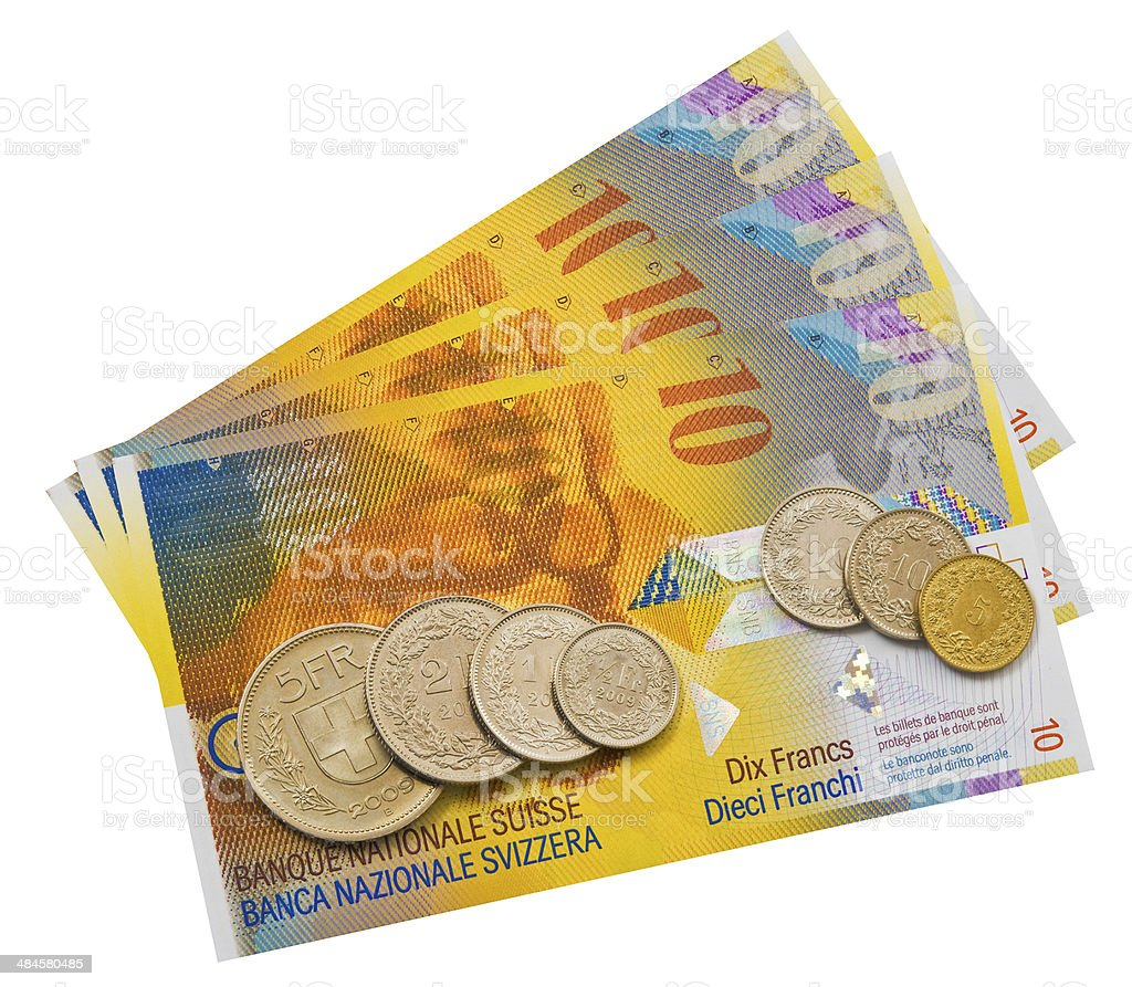 Coins and colorful bills. stock photo