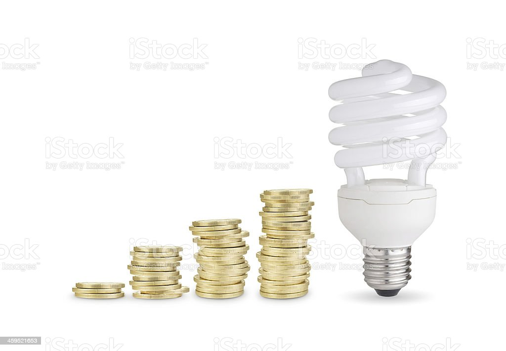 Coins and energy saver bulb stock photo