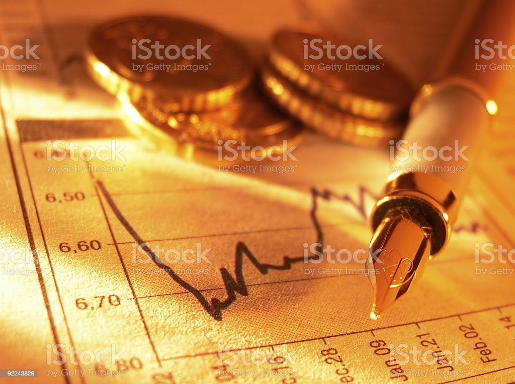 Coins and fountain pen on stock page royalty-free stock photo