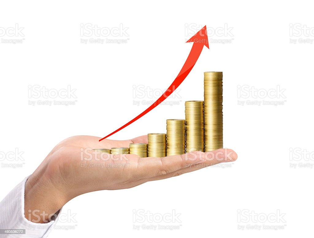 Coins and graph in hand stock photo