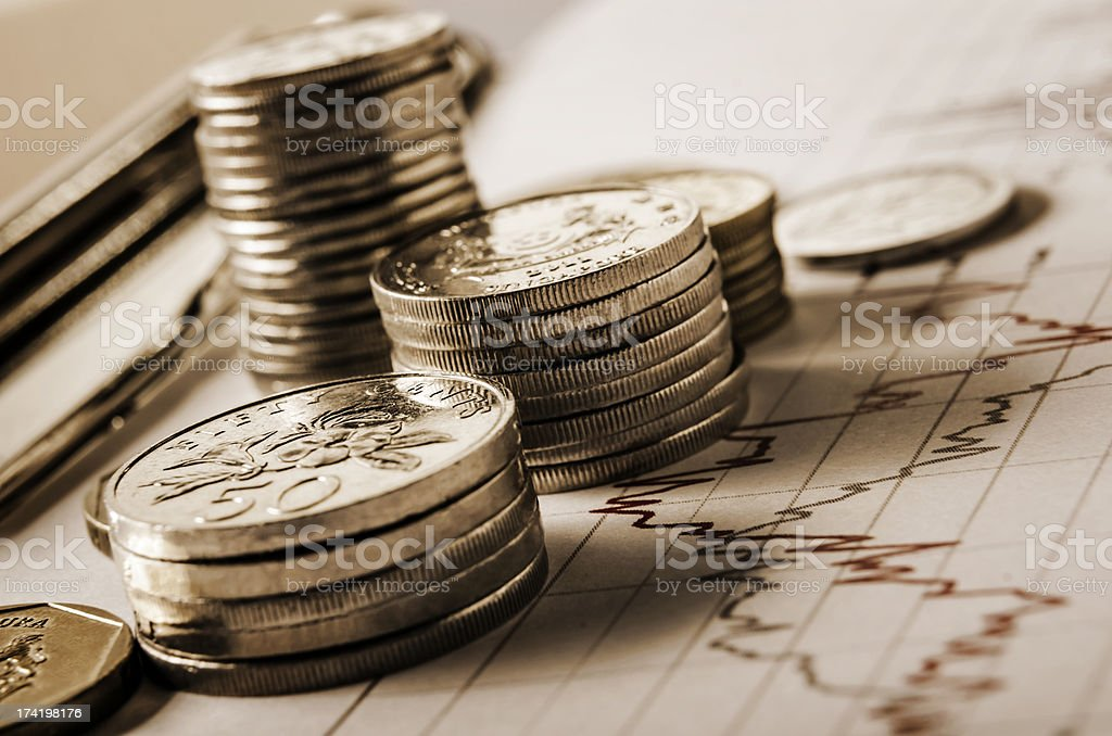 Coins and graph stock photo