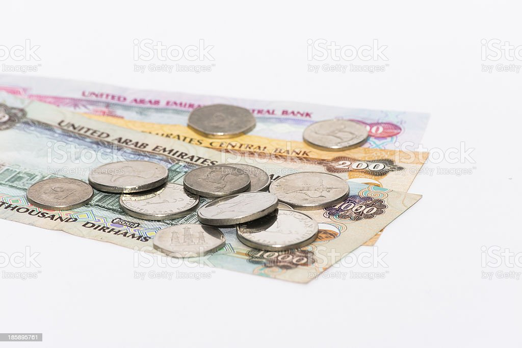 UAE coins and notes on white royalty-free stock photo