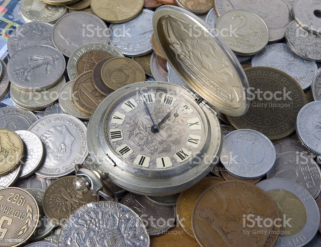 coins and old watch royalty-free stock photo