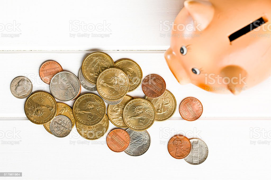 U.S. coins and piggy bank stock photo