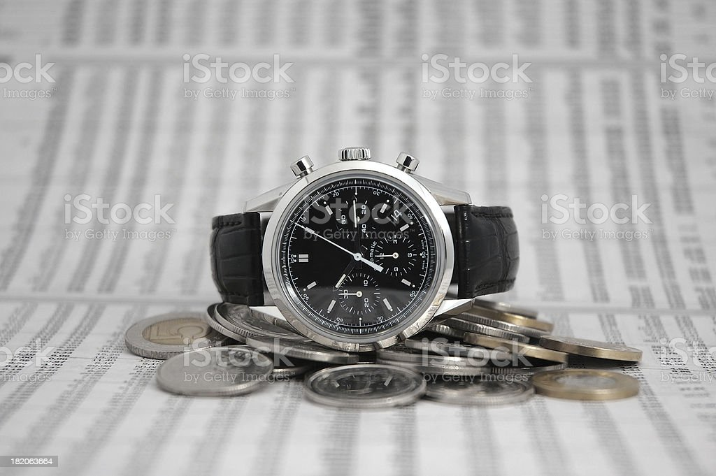 coins and watch royalty-free stock photo