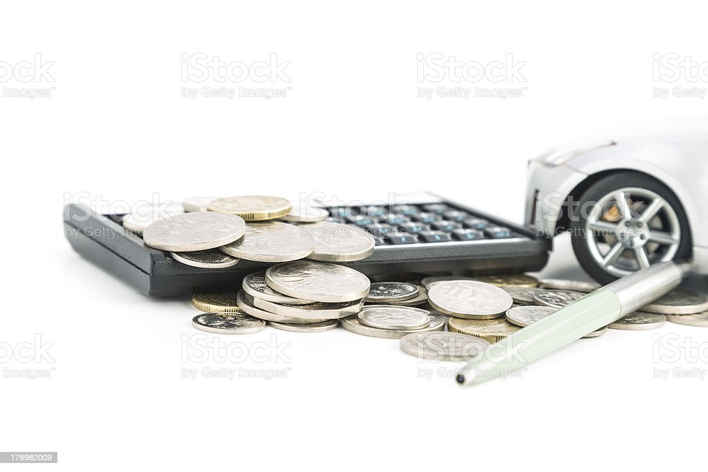 Coins, Calculator, pen and car royalty-free stock photo