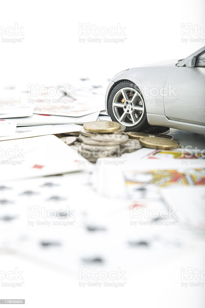 Coins, cards and a car royalty-free stock photo