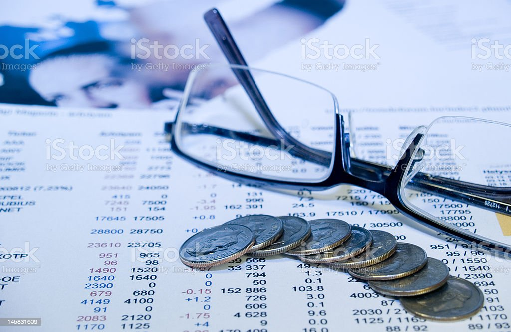 Coins, glasses and numbers royalty-free stock photo