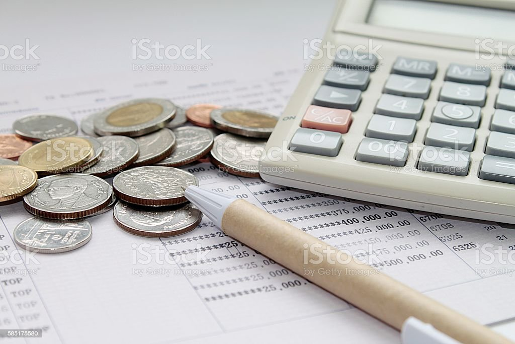 Coins Money Calculator Glasses And Pen On Savings Account Passbook