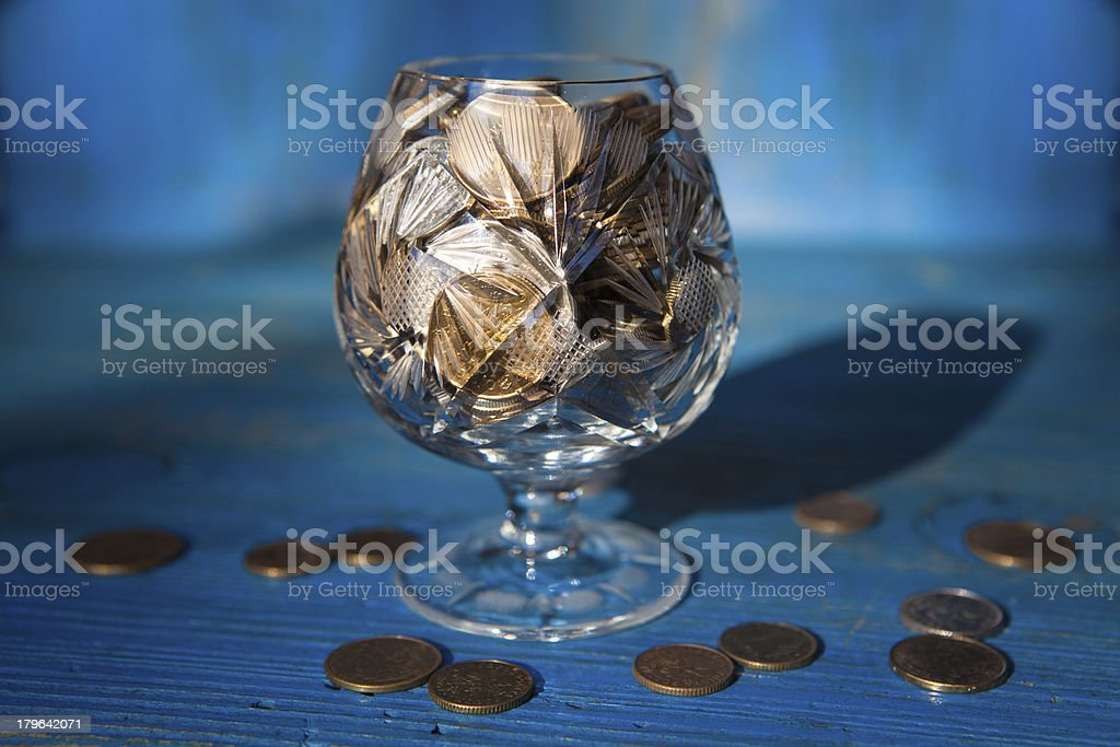 Coins in a crystal glass royalty-free stock photo