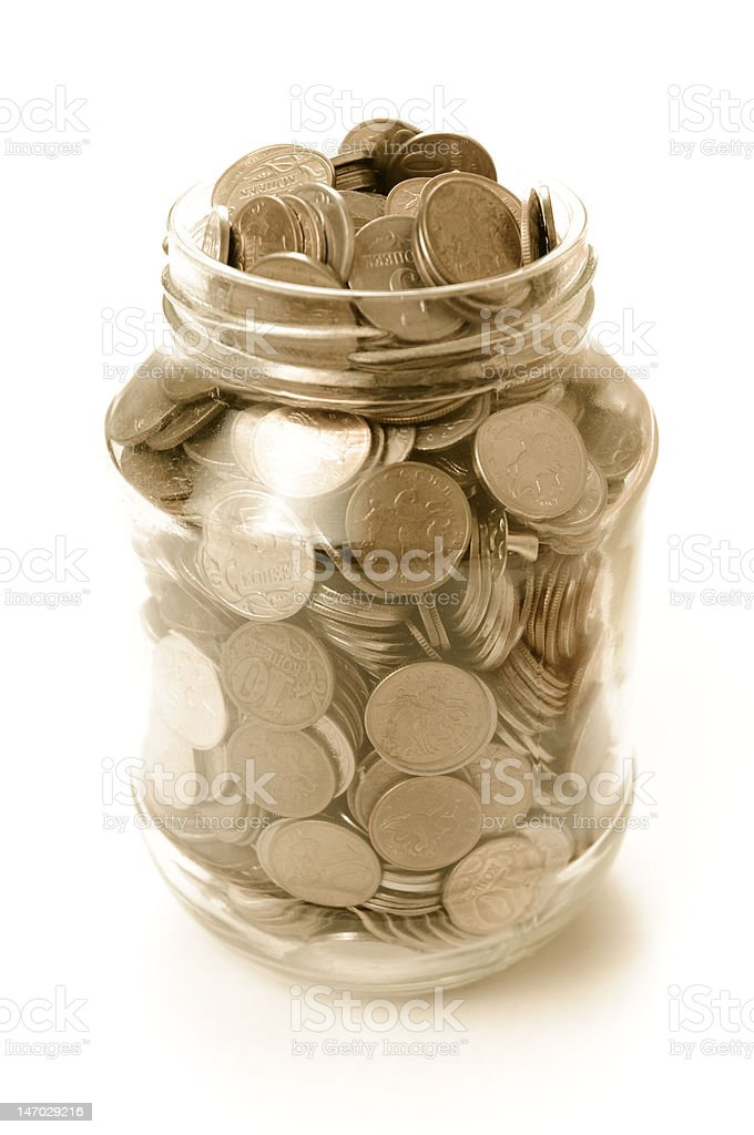 Coins in a glass bank stock photo