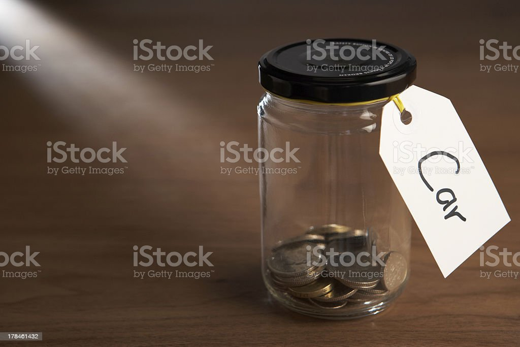Coins in a jam jar stock photo