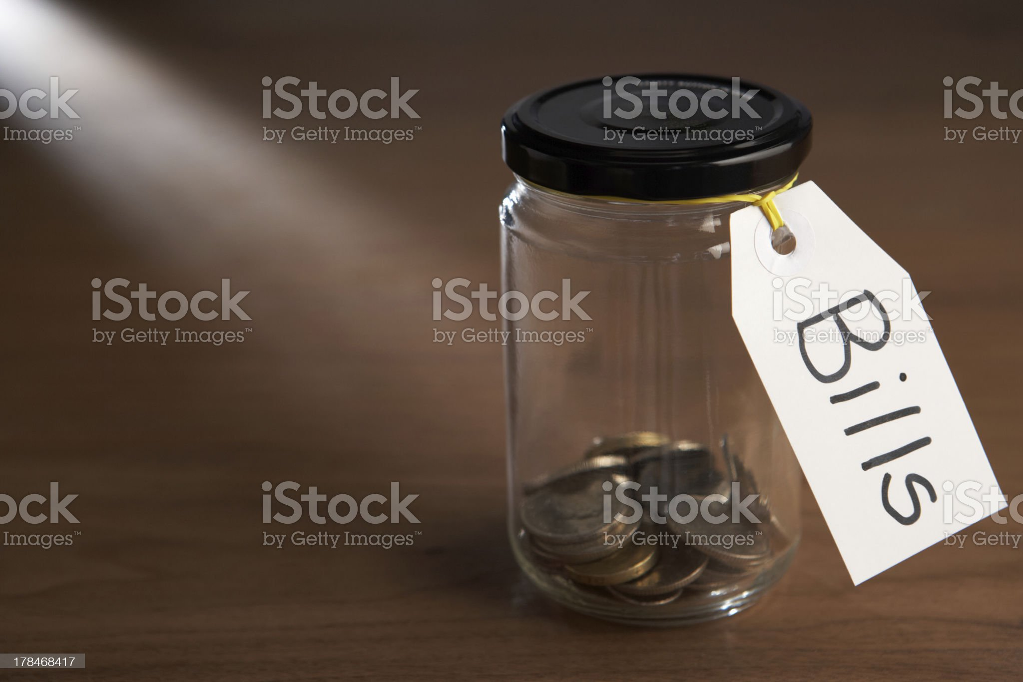 Coins in a jam jar royalty-free stock photo