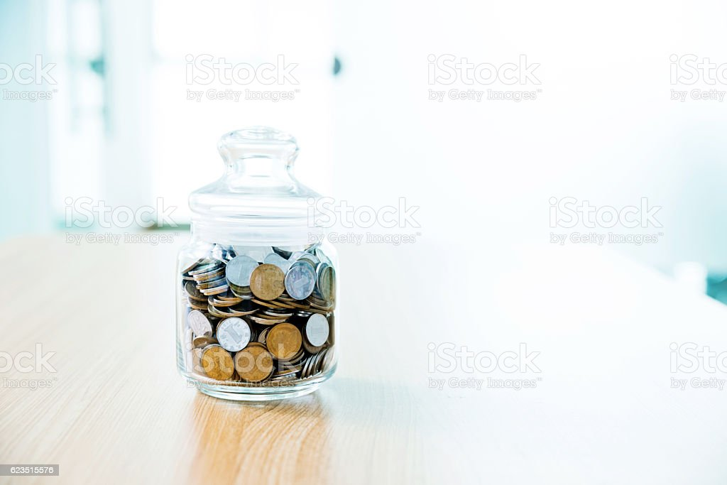 Coins in a jar stock photo