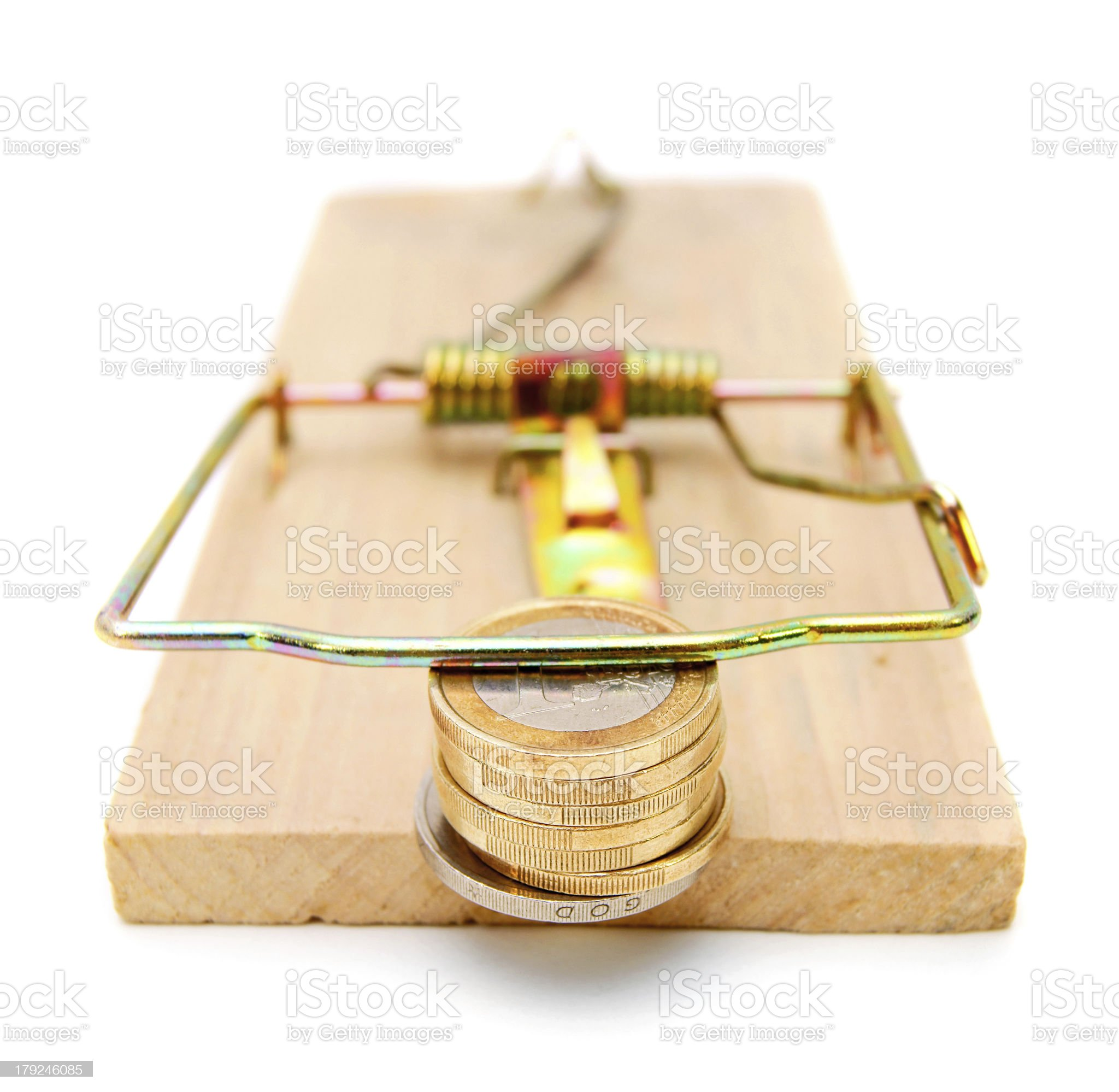 Coins in a mousetrap. royalty-free stock photo
