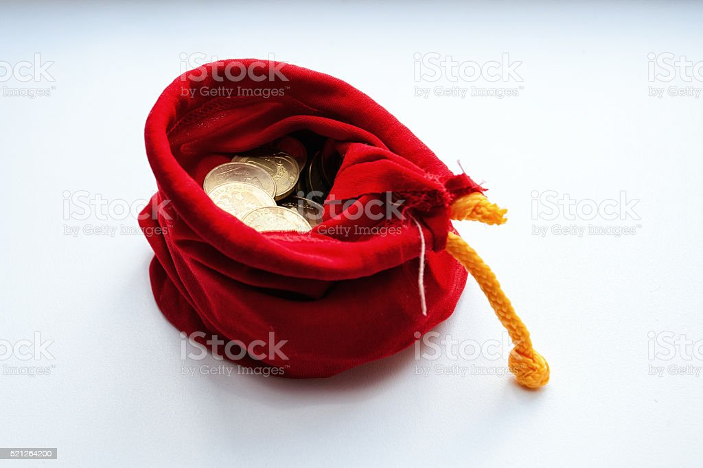 coins in a red sack stock photo