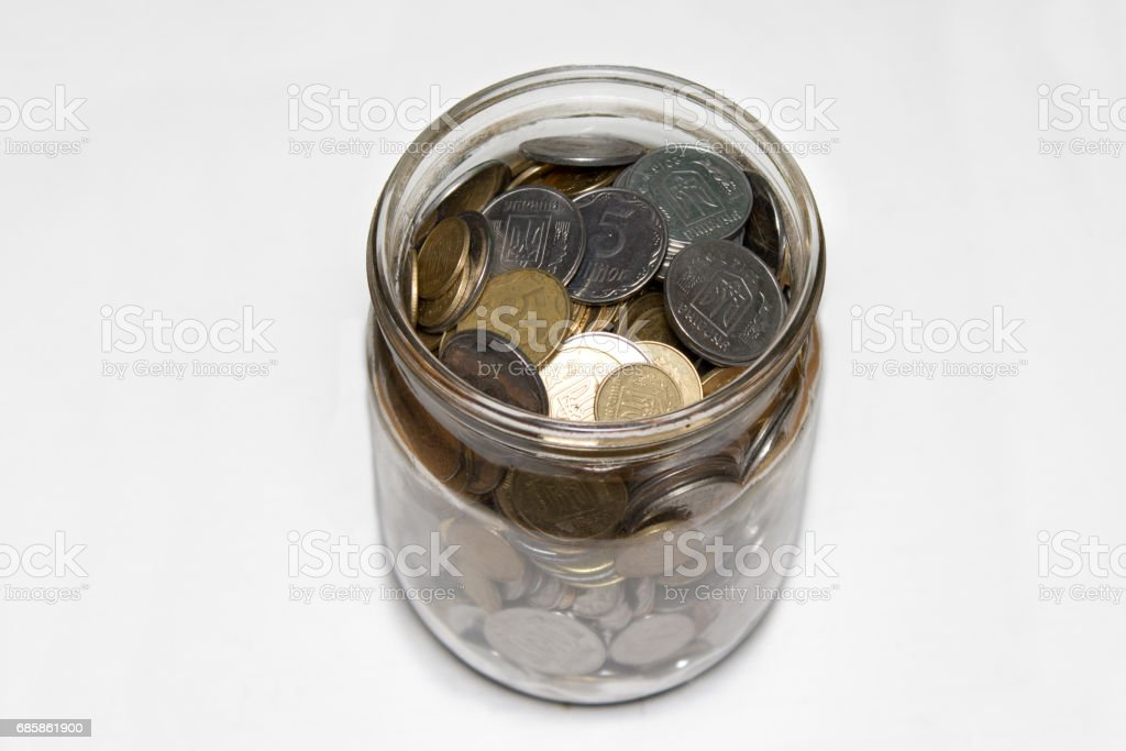 coins in bottle on white background top shot stock photo