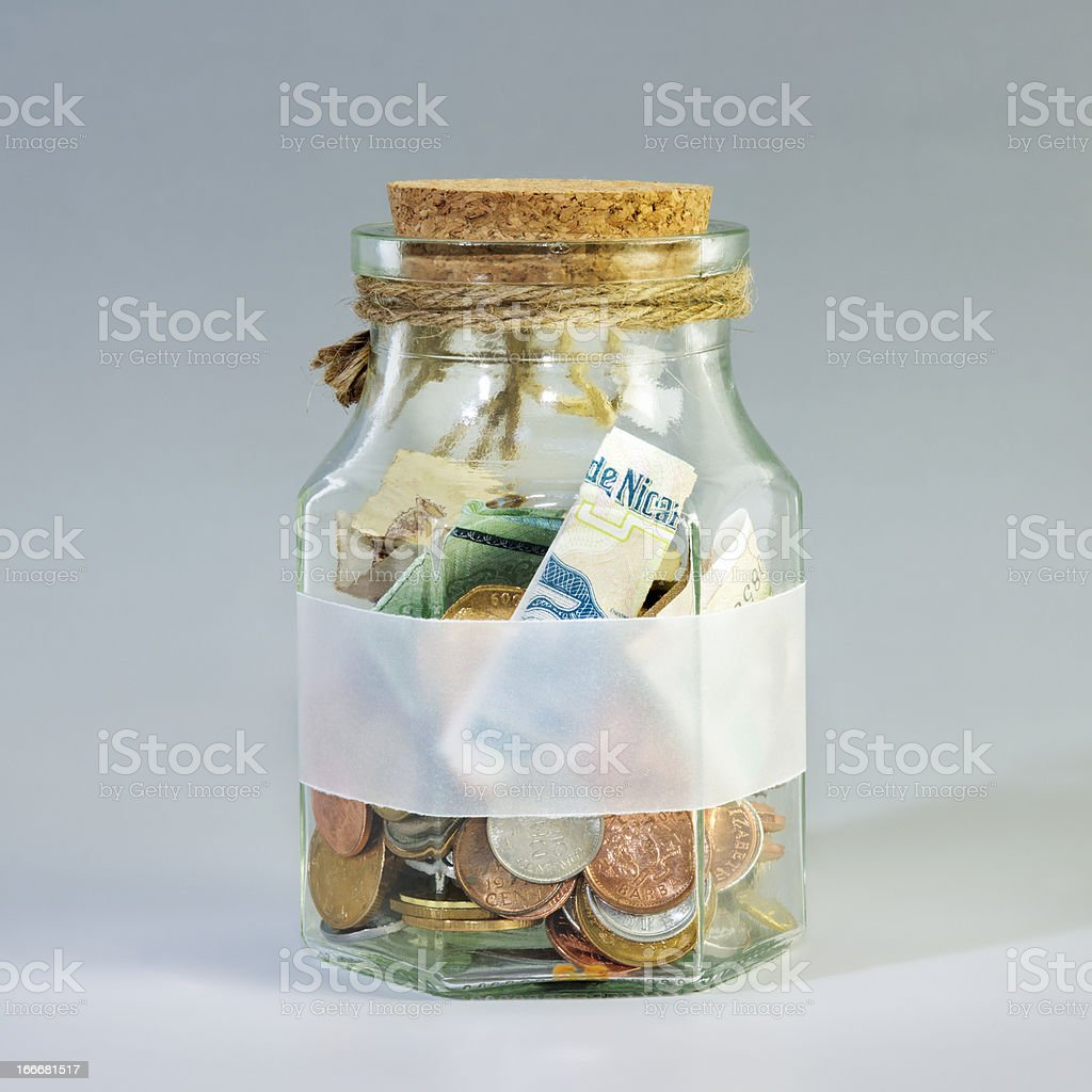 Coins In Glass Bottle stock photo