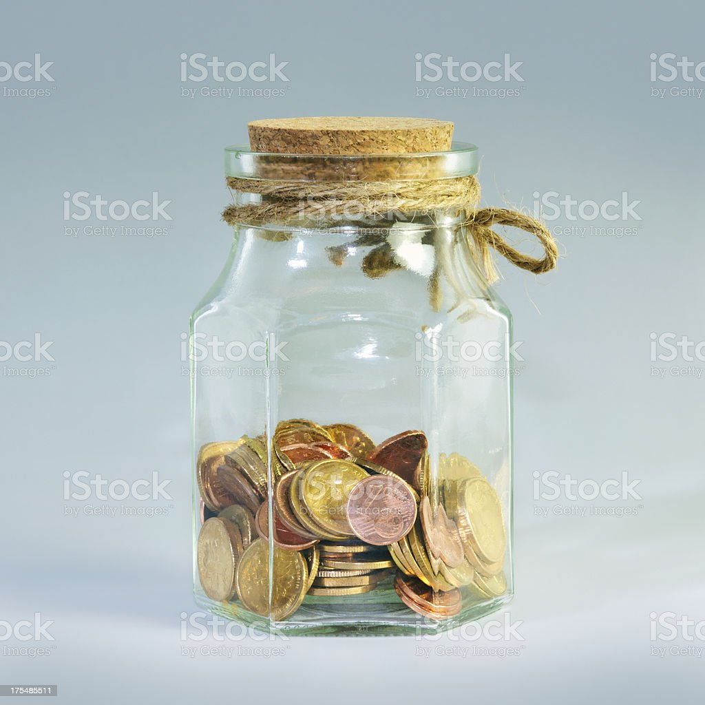 Coins In Glass Bottle royalty-free stock photo