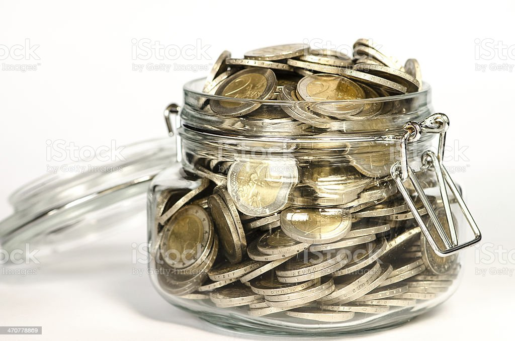 coins in glass stock photo