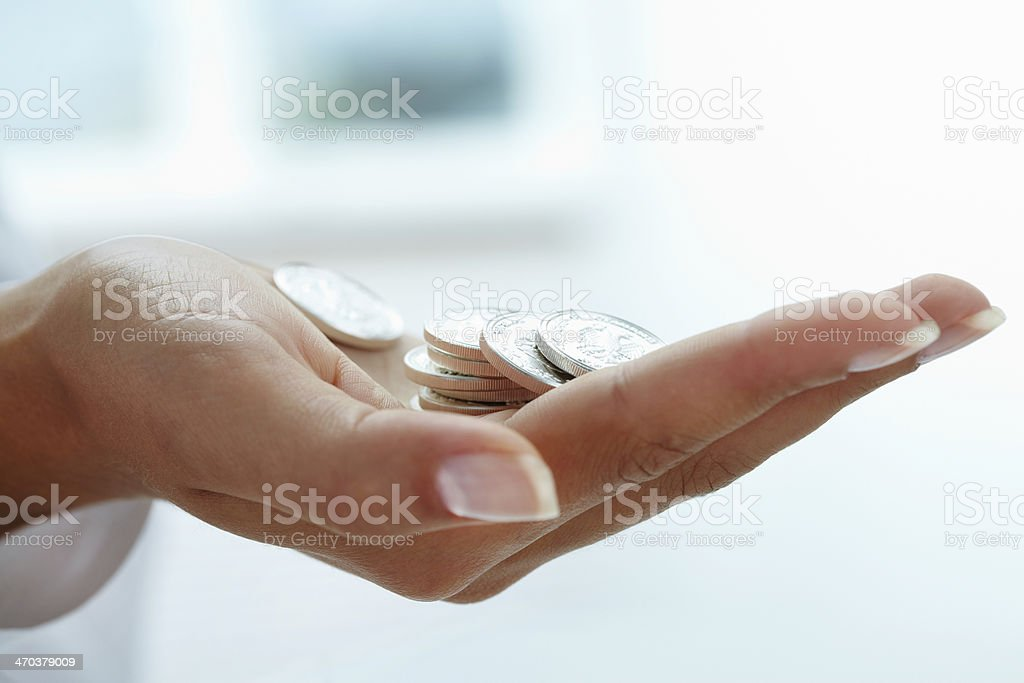 Coins in hand stock photo