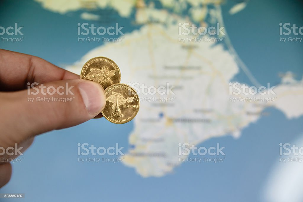 coins in honor of the Crimea to Russian Federation stock photo
