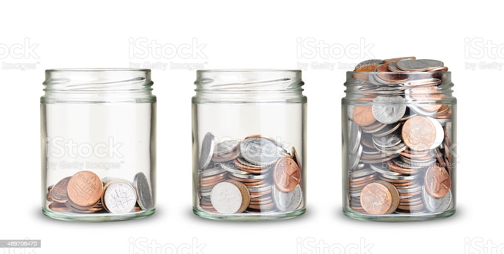 coins in jars stock photo