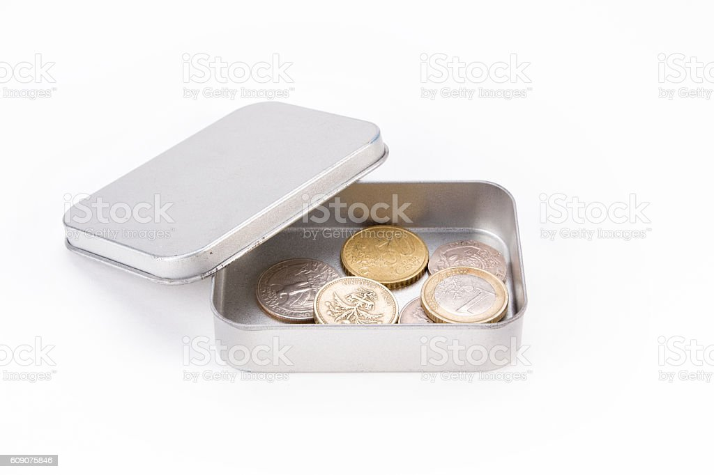 Coins in metal box stock photo
