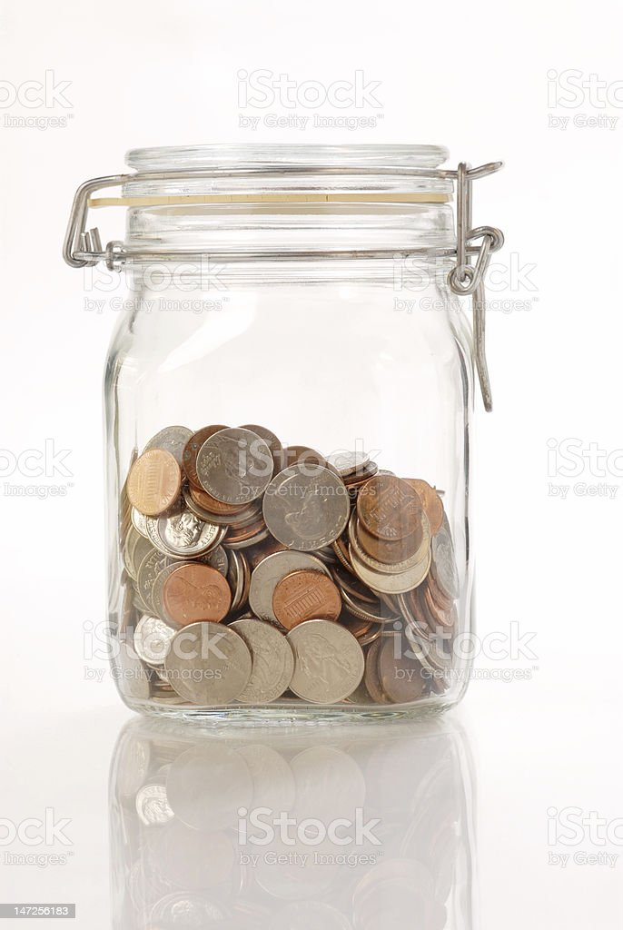 coins in the glass jar stock photo